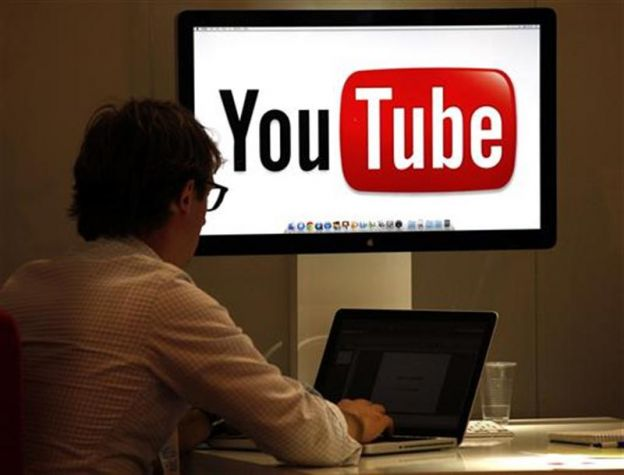 A visitor is seen at the You Tube stand during the annual MIPCOM television programme market in Cannes