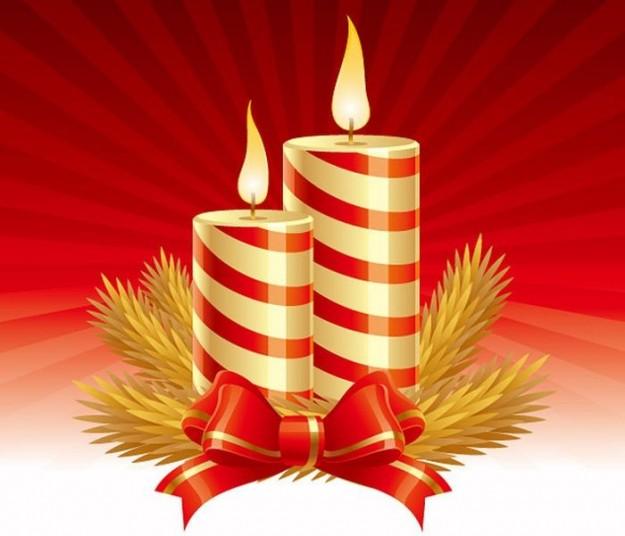 Candele di Natale e fiocco rosso